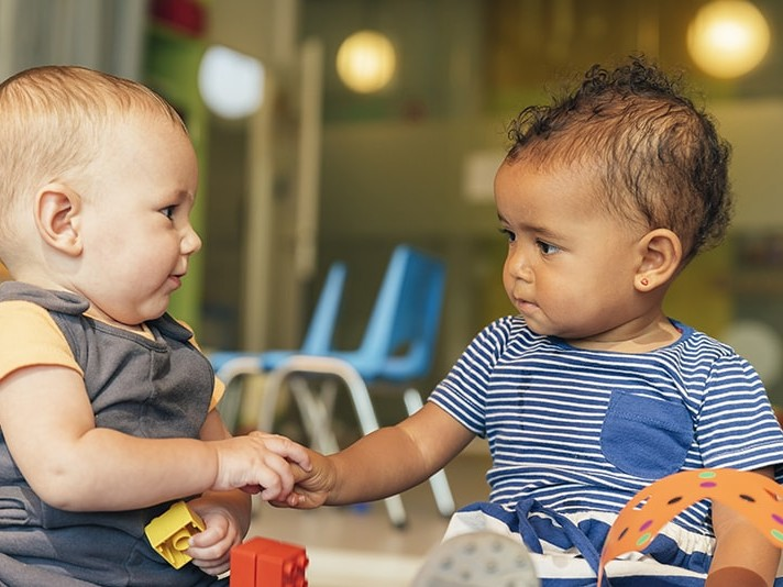 Two toddlers receiving pediatric care